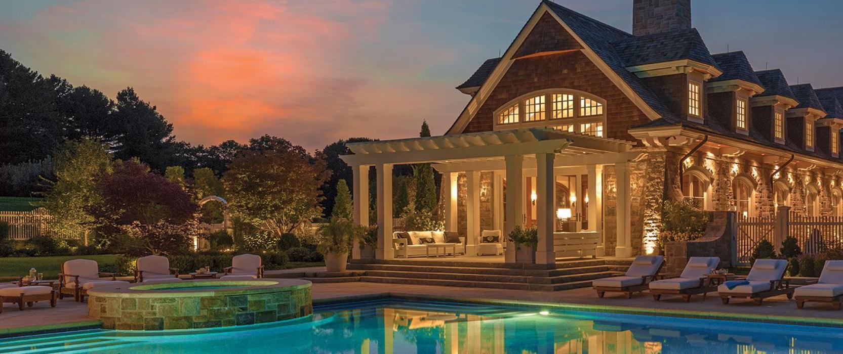 Illuminated pool terrace by Sudbury Design Group