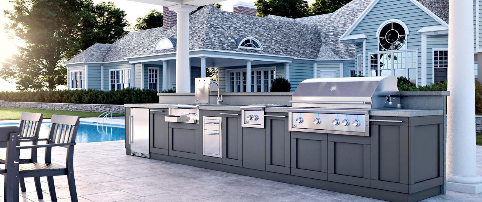 Outdoor kitchen in backyard next to pool