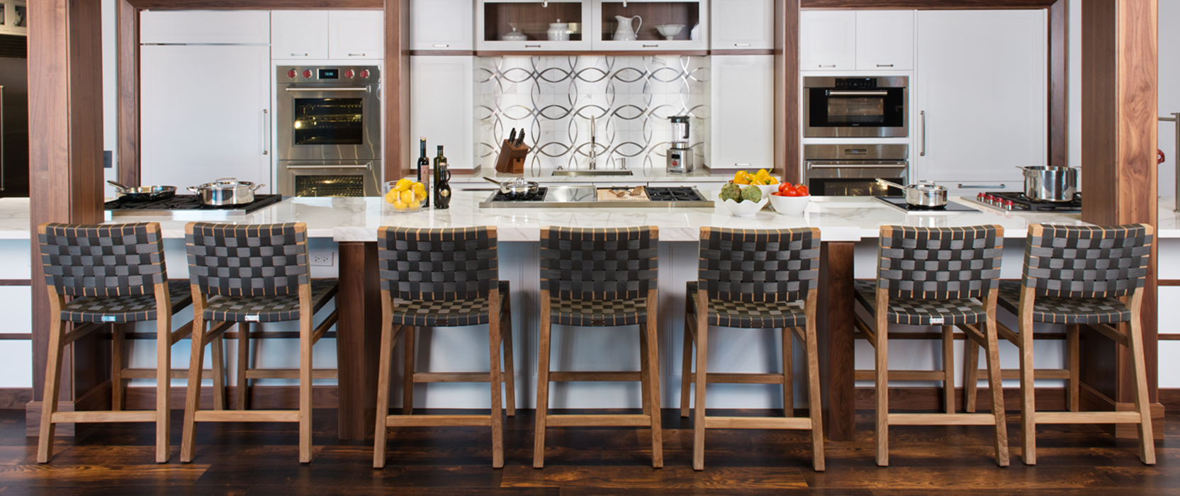 Clarke showroom kitchen with long island set up with seven stools