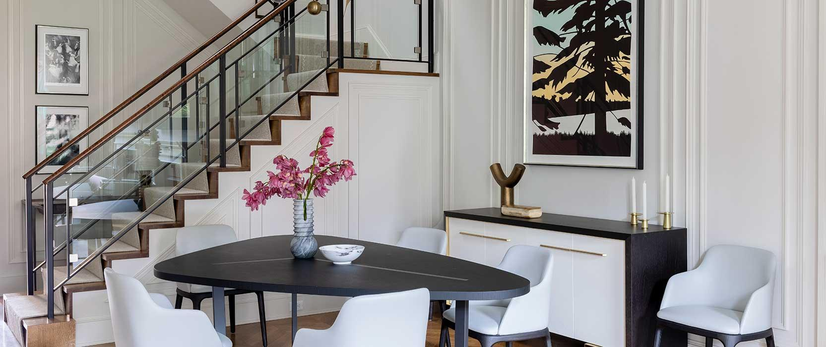 Dining table situated in front of stairs