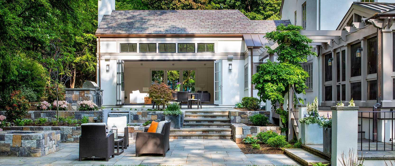 backyard with sunroom that opens on to the patio