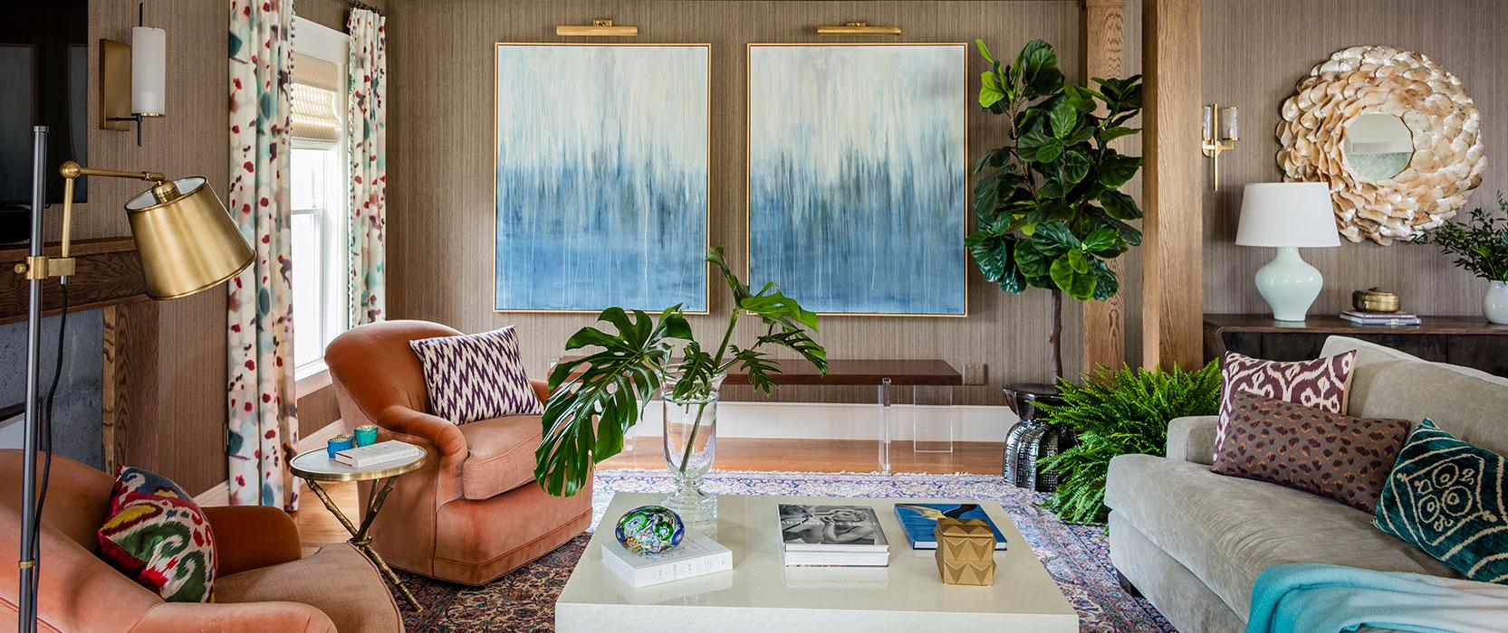 colorful living room design with wood paneling and blue abstract art on the walls