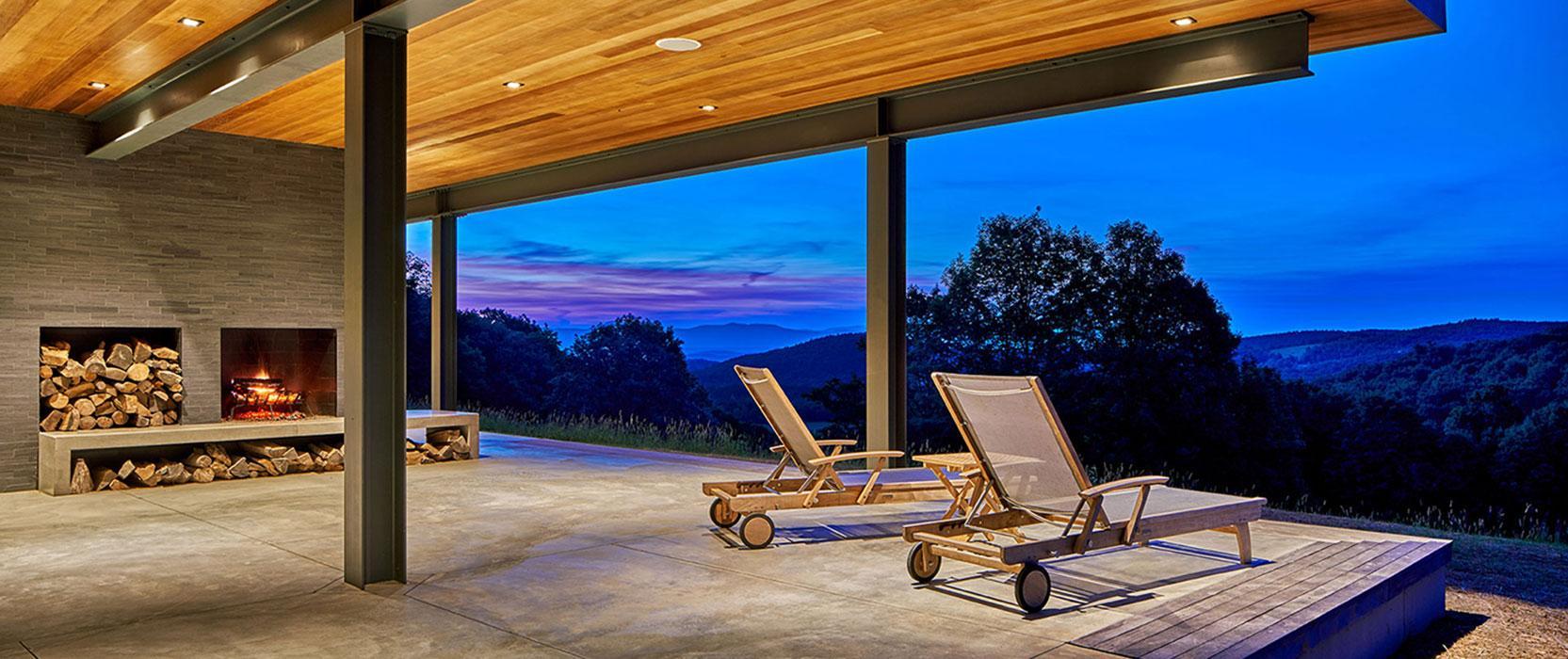 Cantilevered fireplace terrace by Matthew Cunningham Landscape Design