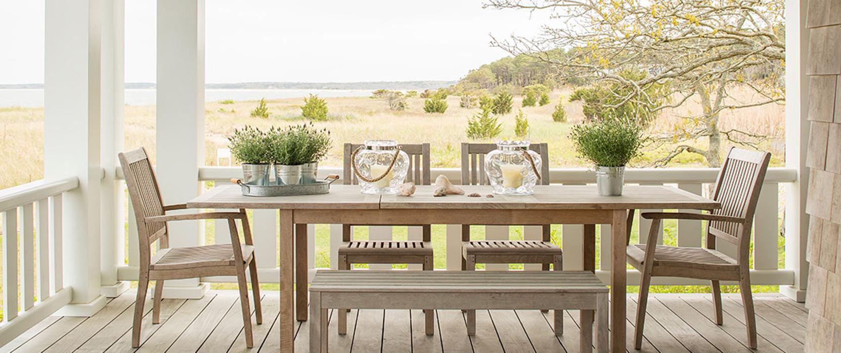 dining table on porch overlooking the marsh and ocean