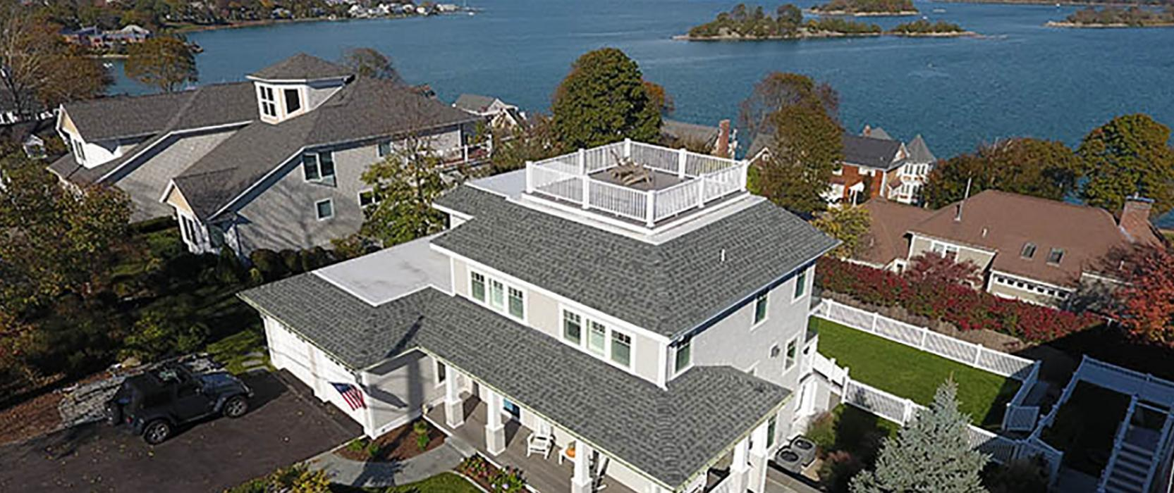 Waterfront renovation with roof deck