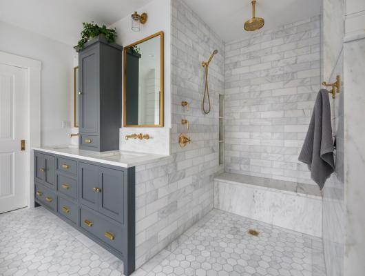 Remodeled master bath with White marble and unlacquered brass fixtures