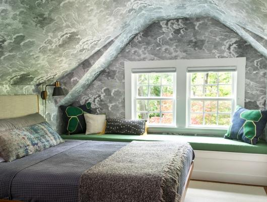 Bedroom with ceiling wallpaper based on a Moroccan tile roof