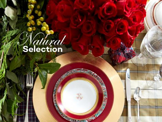 Holiday place setting with greenery and roses