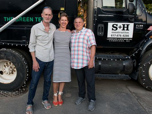 Founders Alex Slive and Doug Hanna of S+H Construction flank President and Owner Sarah Lawson