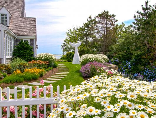 A coastal garden with a touch of whimsy by Schumacher Companies