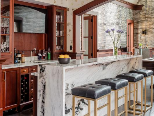 bar area with black cushioned stools