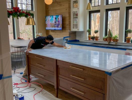 Boston Stone Restoration refines and polishes a marble kitchen island