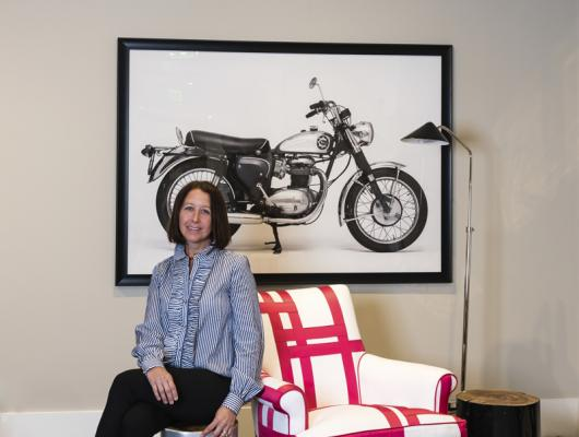 "Elizabeth Benedict of Elizabeth Home Décor & Design with her chair ""Charlotte's Web"""
