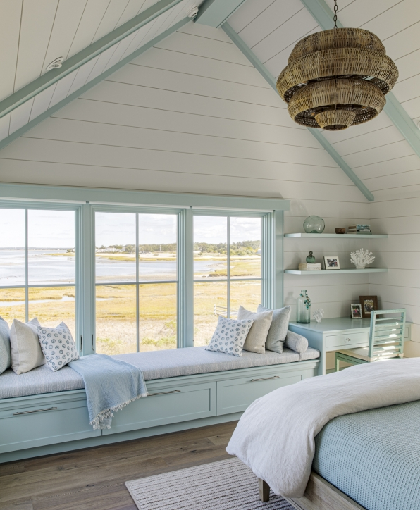 Bedroom window seat with custom cabinets below and overlooking the water