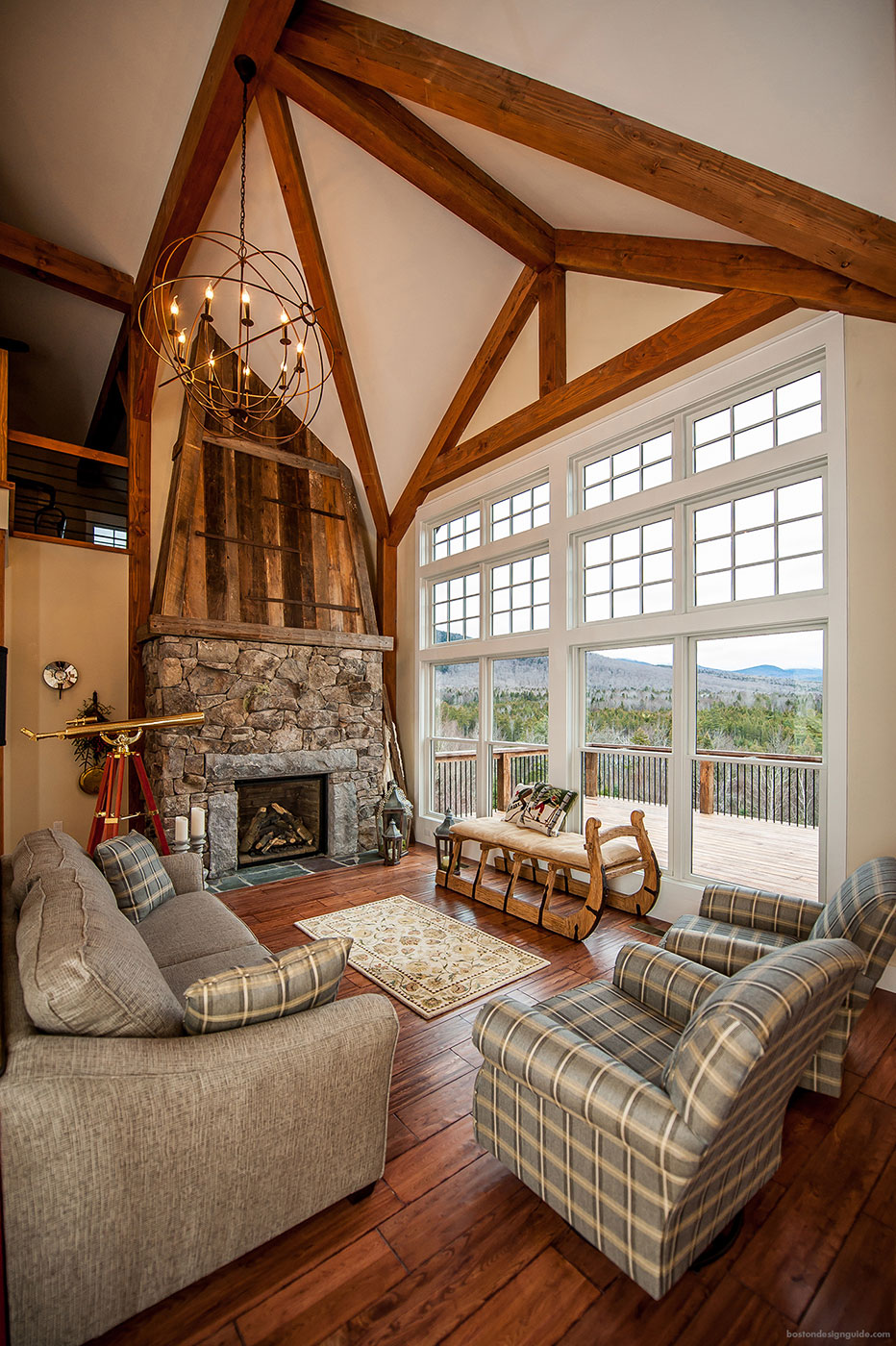 Fireplace in a mountain home by Yankee Barn Homes